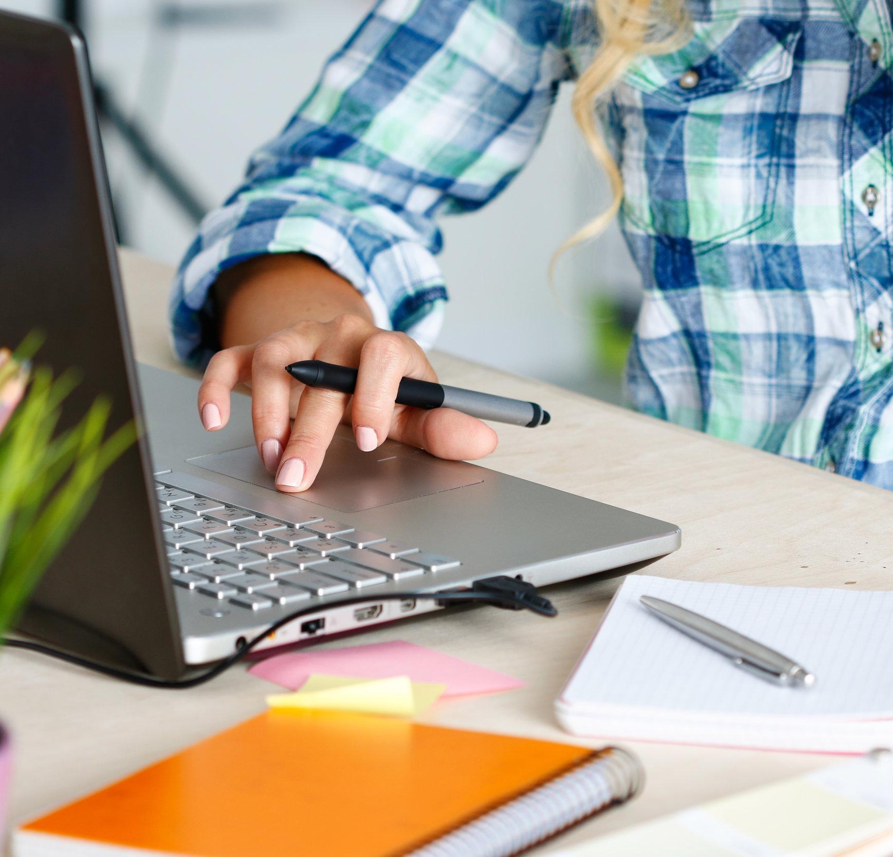 stock-photo-92673597-hands-of-female-designer-in-office.jpg