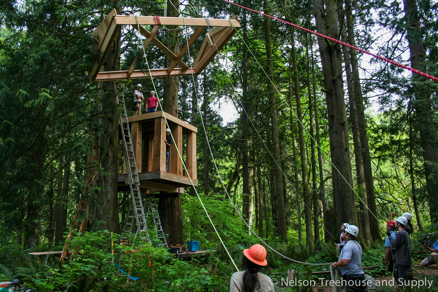 Community of treehouse enthusiasts building the Bonbibi at a workshop at Treehouse Point.