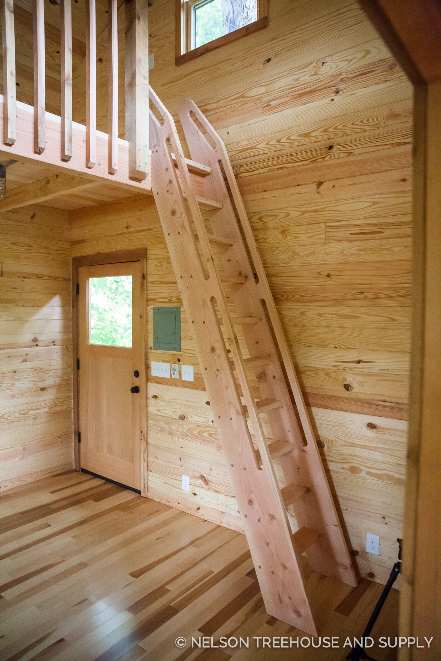 Ships ladder takes guests to the loft inside a treehouse in Tennessee.