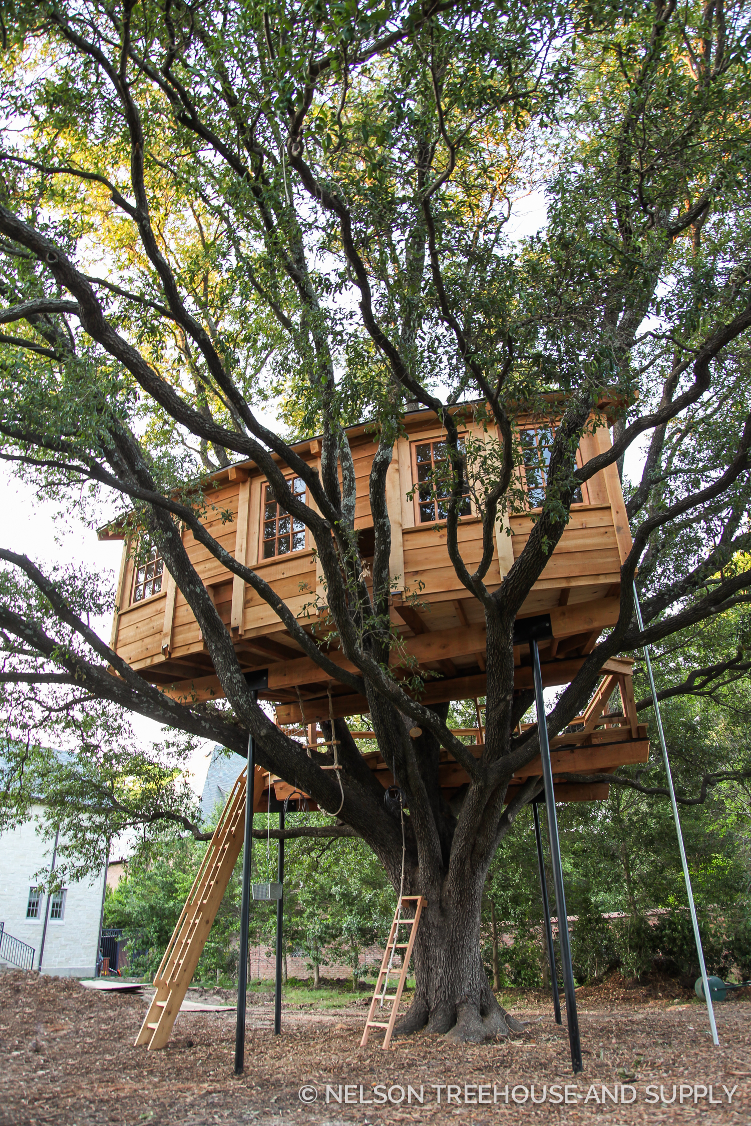Ships ladder leads to the viewing deck on this treehouse in Texas.