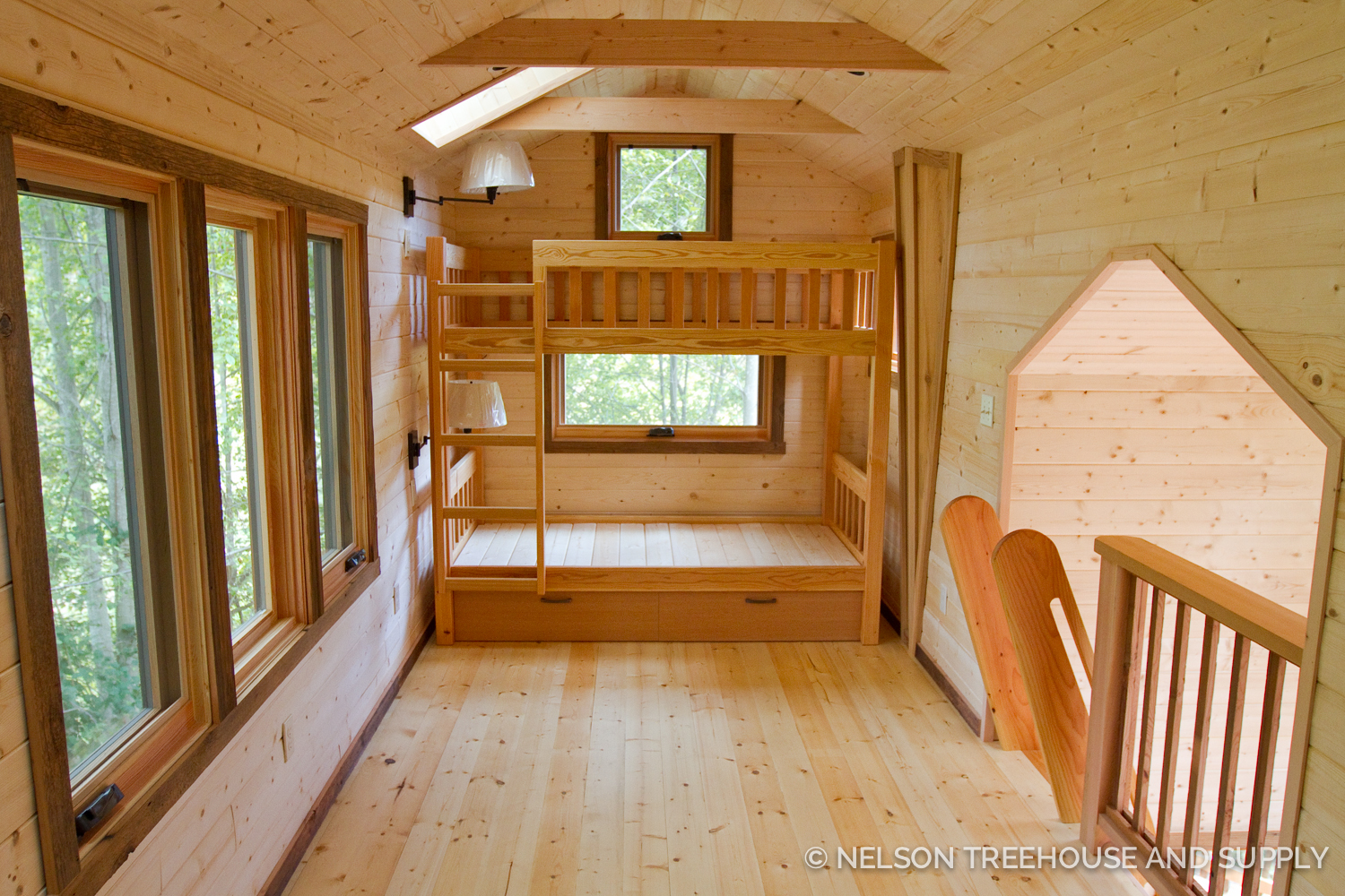 Daryl's design included pine wood paneling and an arboreal loft for the clients' grandchildren.