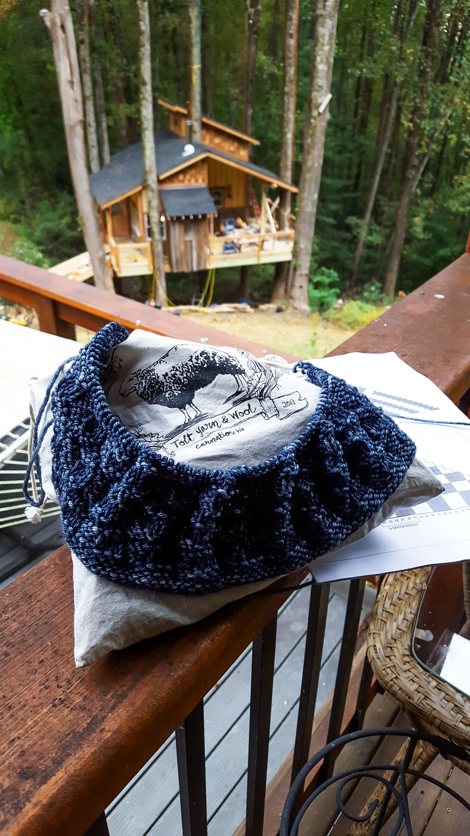 Judy's Knitting on the Build Site of Mike Reynold's Treehouse