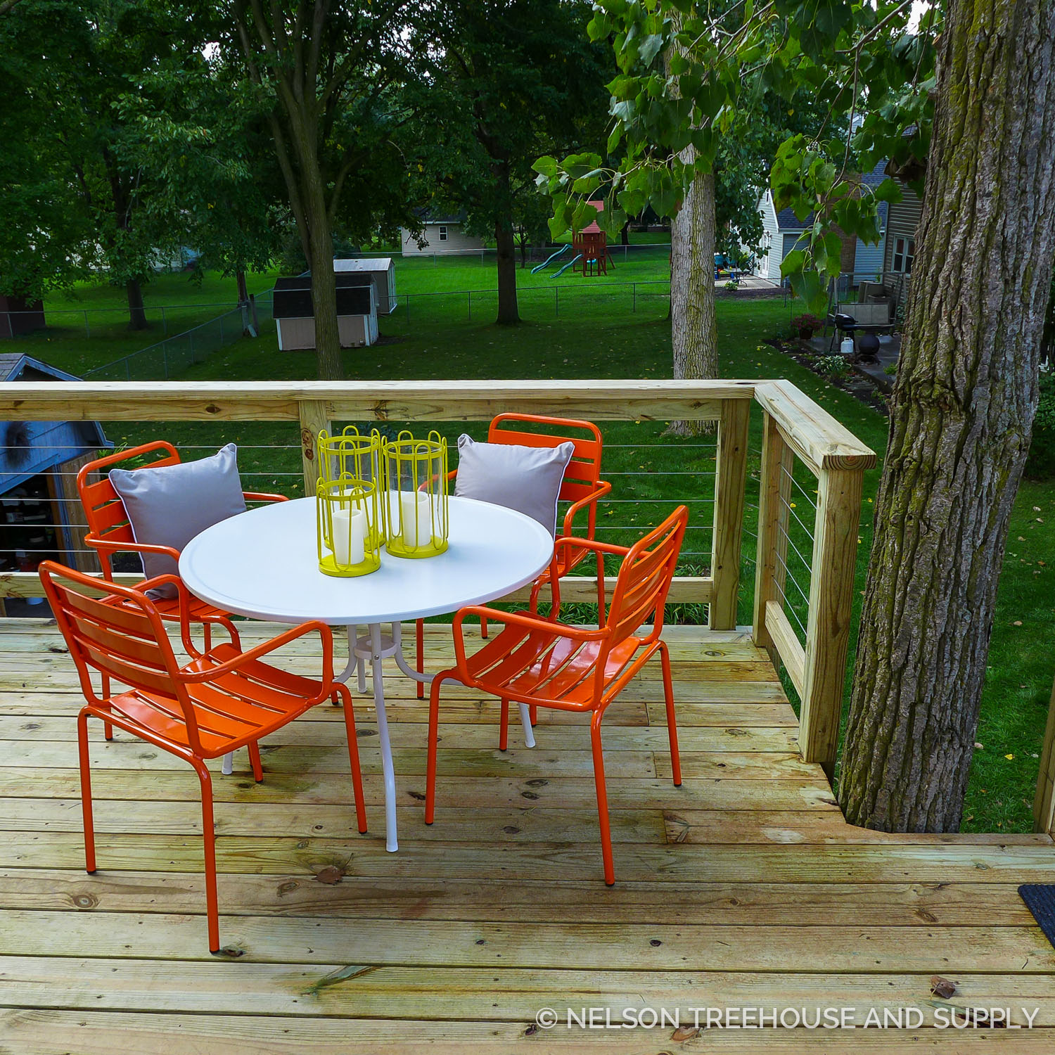 Christina sought budget-friendly, cheerful, modern-looking pieces for the Smith's treehouse. She found most of the outdoor furniture at Target, Overstock.com, and HomeGoods.