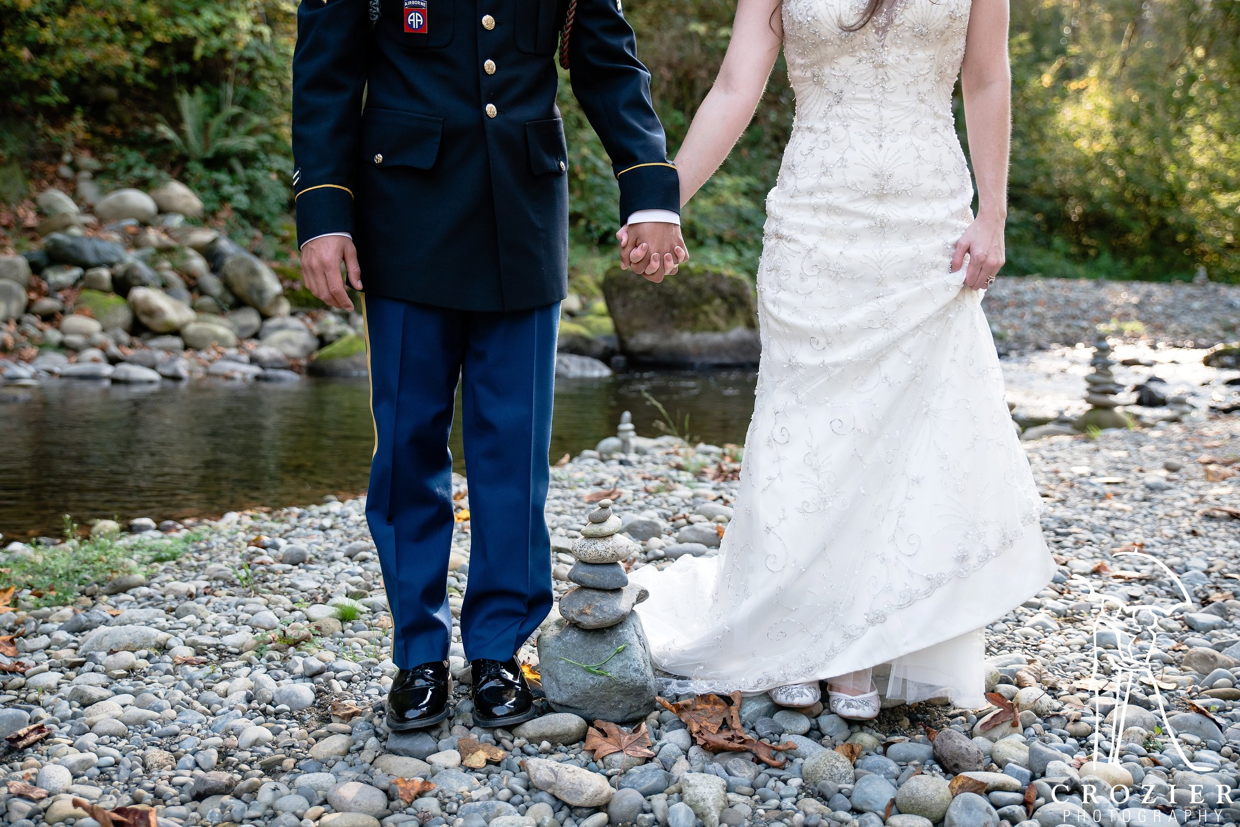 Many guests at TreeHouse Point (including  this sweet bride and groom ) enjoy building cairns on the banks of the Raging River. Photo by  John Crozier .