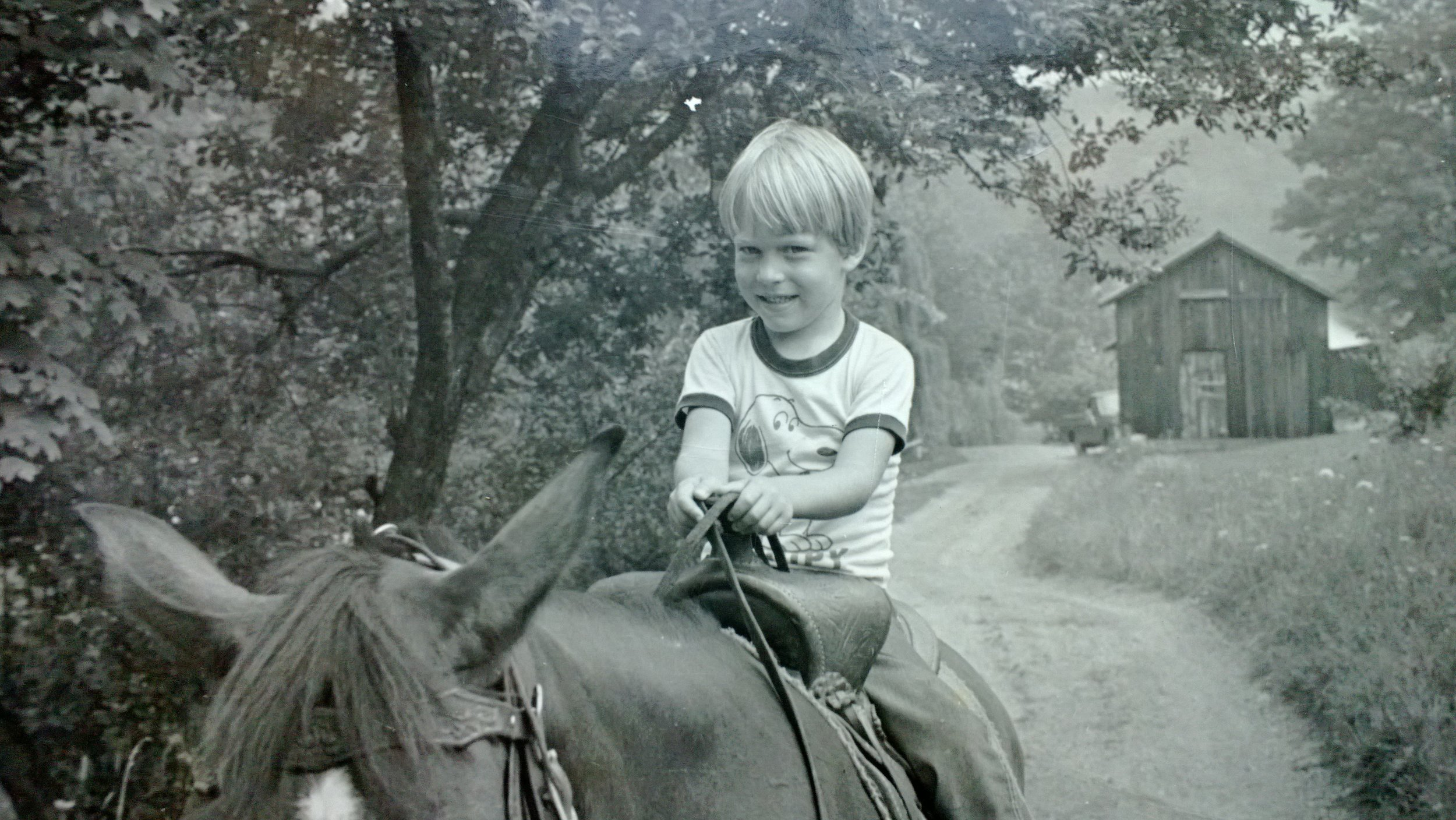Toby riding a family friend's horse near his childhood home in Pennsylvania.