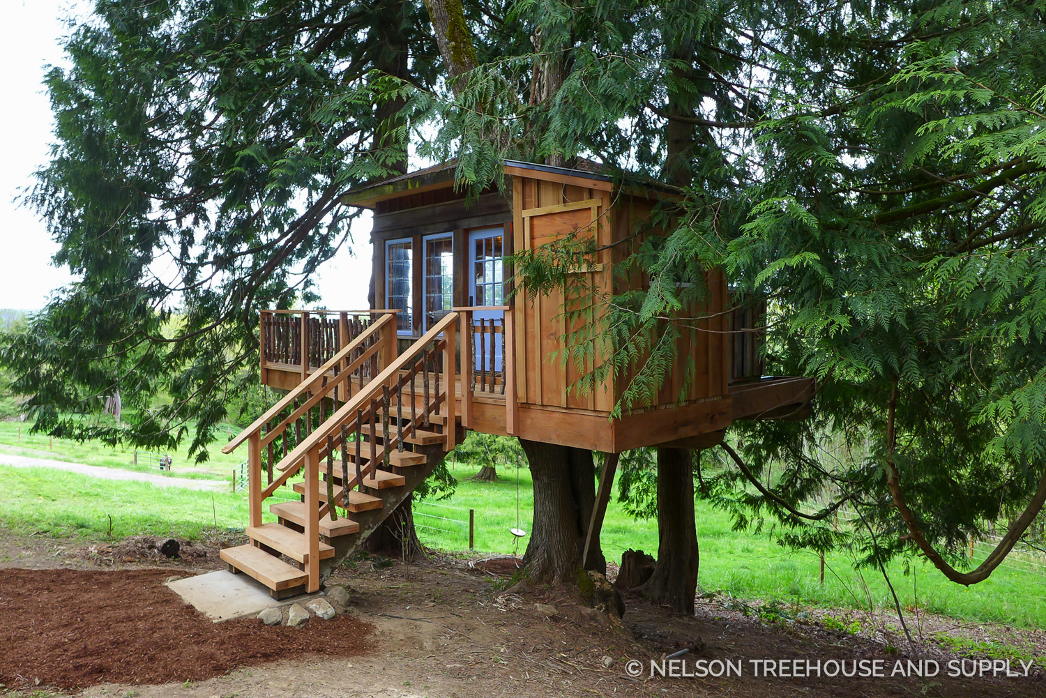 Updating the treehouse with pressure-treated wood, metal flashing, and sturdy railings will keep this treehouse safe and strong for years to come.