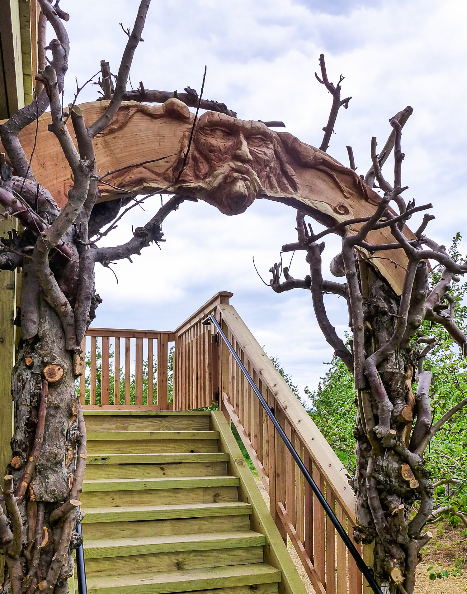 You might recognize Rolf's artwork from the  Angry Orchard treehouse  - he carved the face on the arch above the staircase.
