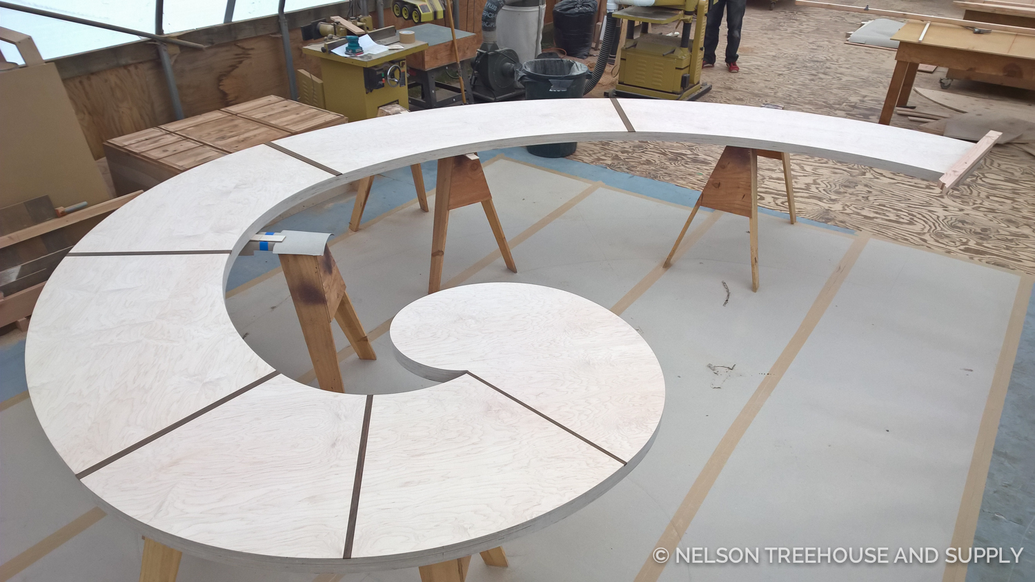 Dylan worked on this built-in, curved bench for the  owl's Nest library treehouse . The design for this bench is based on the fibonacci spiral - you can find out  how to build it here on our blog.