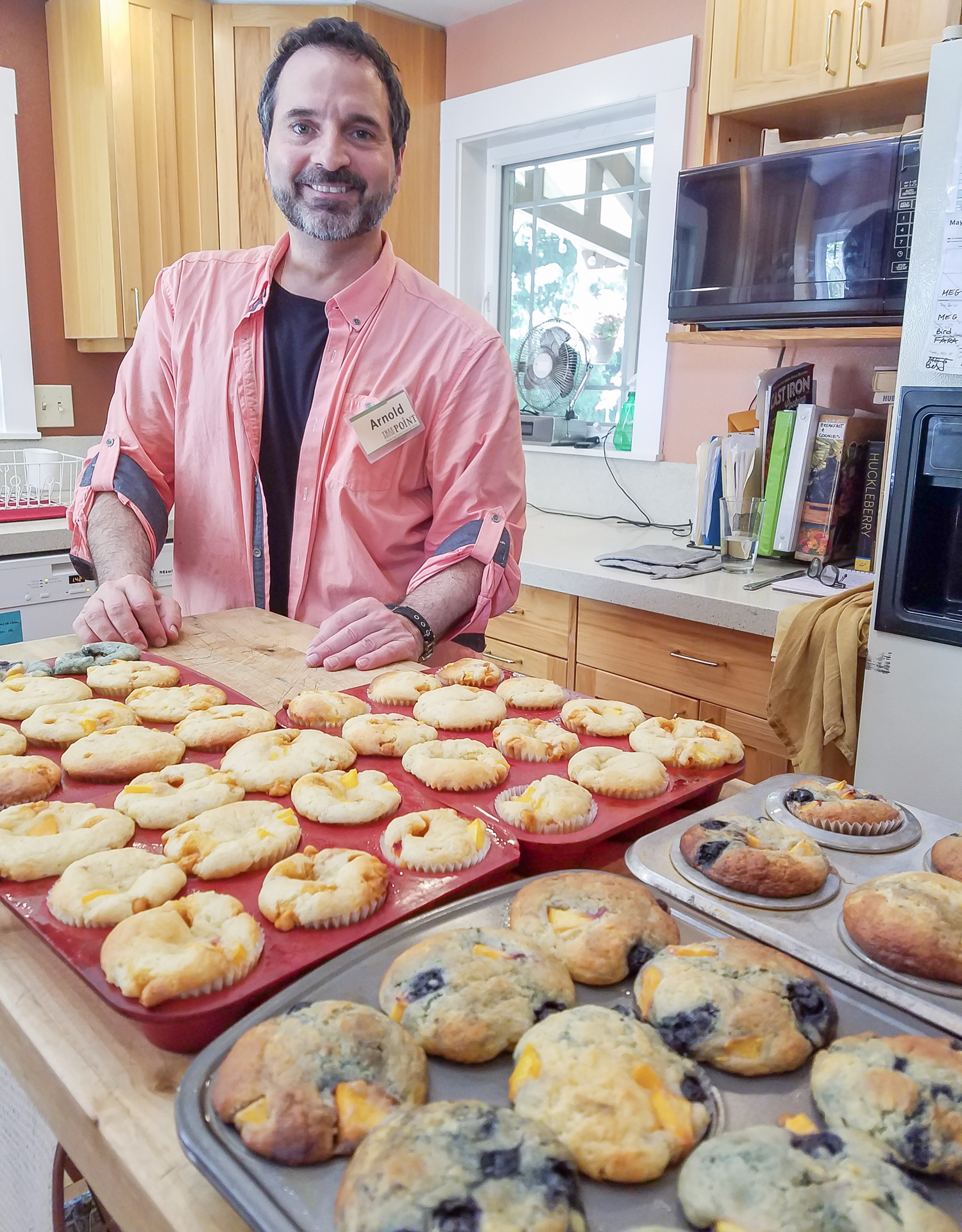 Kitchen Magic! Arnold  J. Mungioli surrounded by muffins in the kitchen at Treehouse Point. All photos courtesy of Arnold.