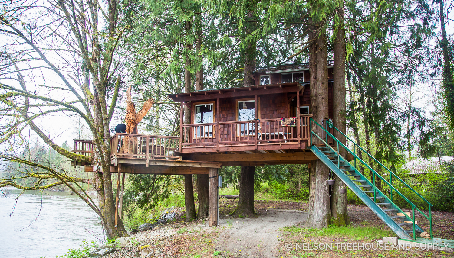 Dylan's dream treehouse would be located near a river for prime fishing access, like this treehouse (owned by  Bruce of Wild edge Woods ) in oso, WA.