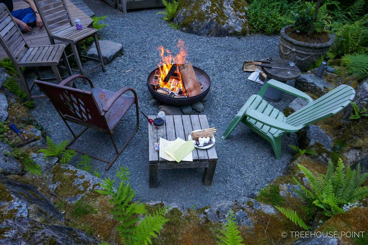 on clear nights, guests gather for s'mores and stargazing at the fire pit next to the lodge.