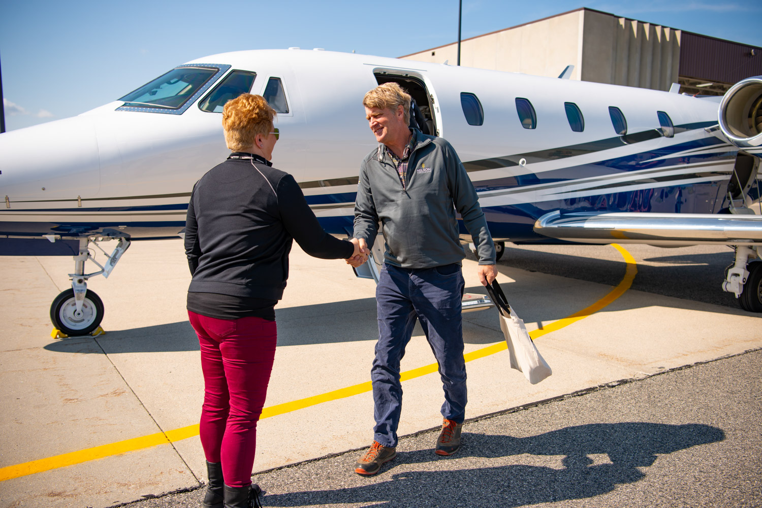 Pete Nelson arriving by Marvin company plane at the Windows and doors Headquarters in Warroad, Minnesota. PHoto courtesy of Marvin Windows.