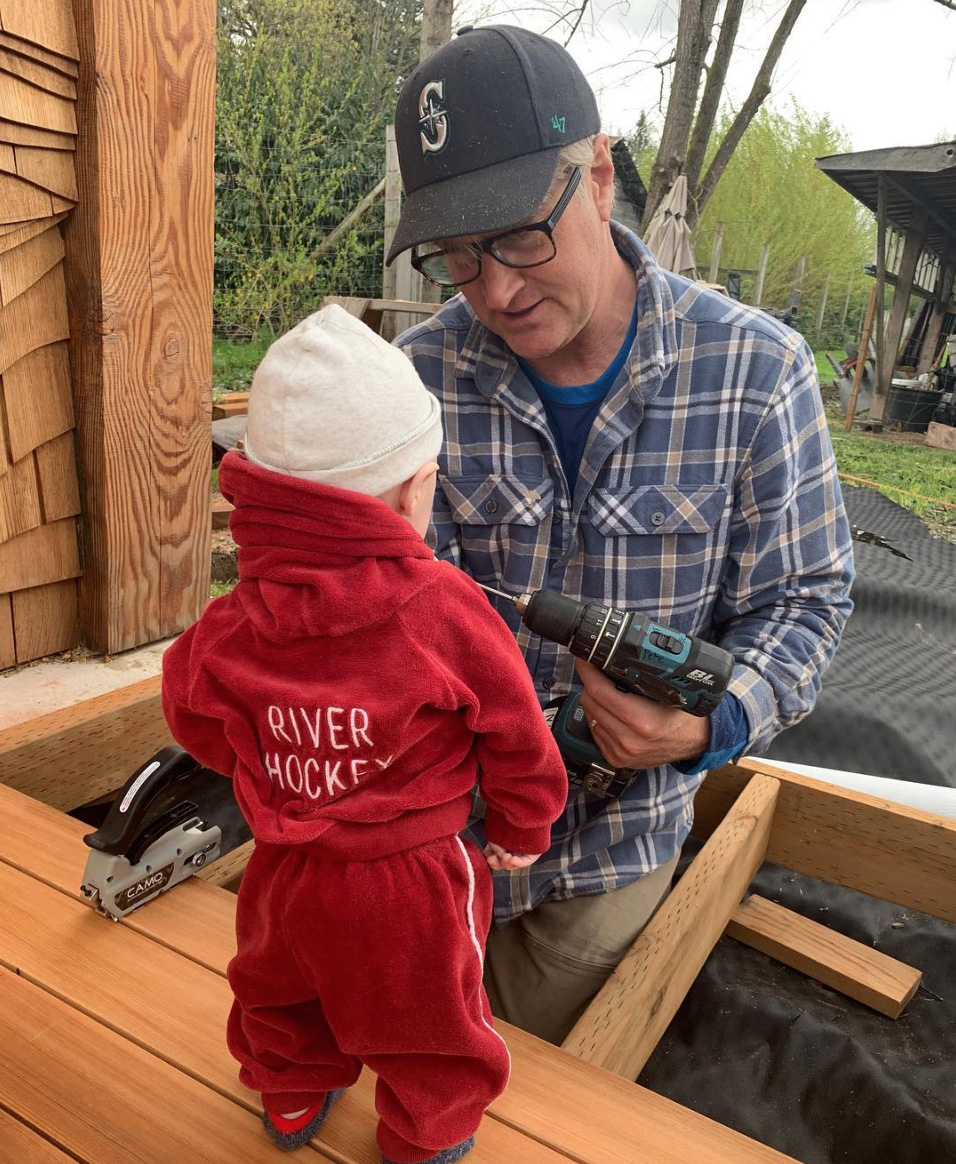 Me giving Douglas his very first carpentry lesson.