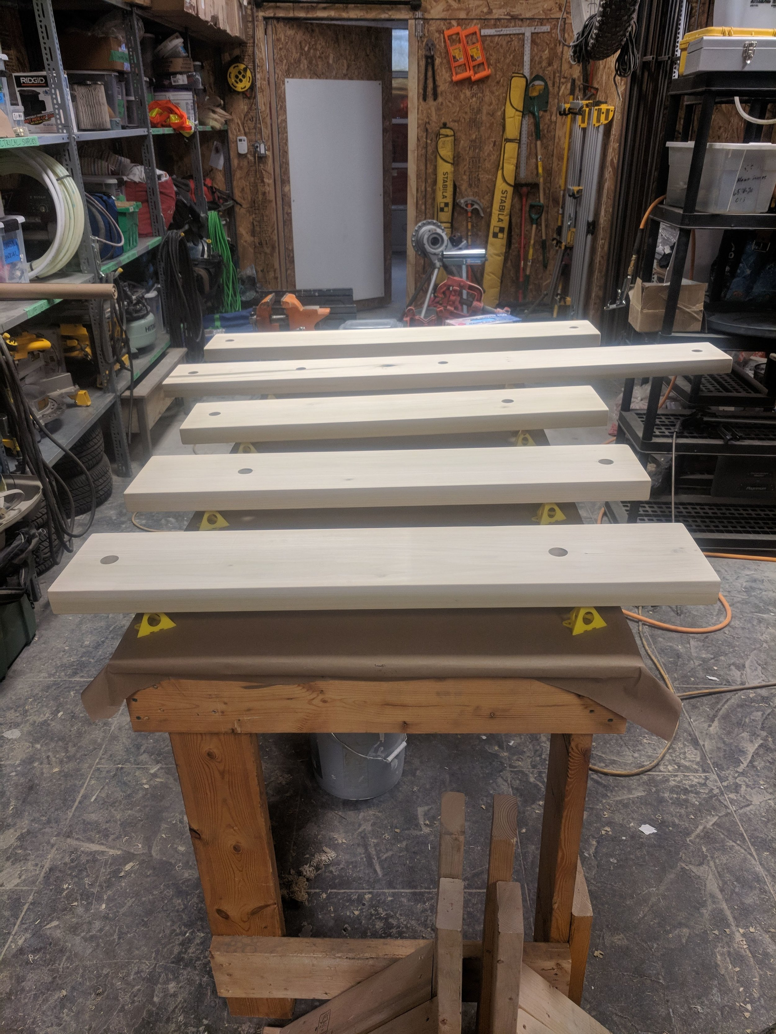 Shelves cut, sanded, and ready for stain.