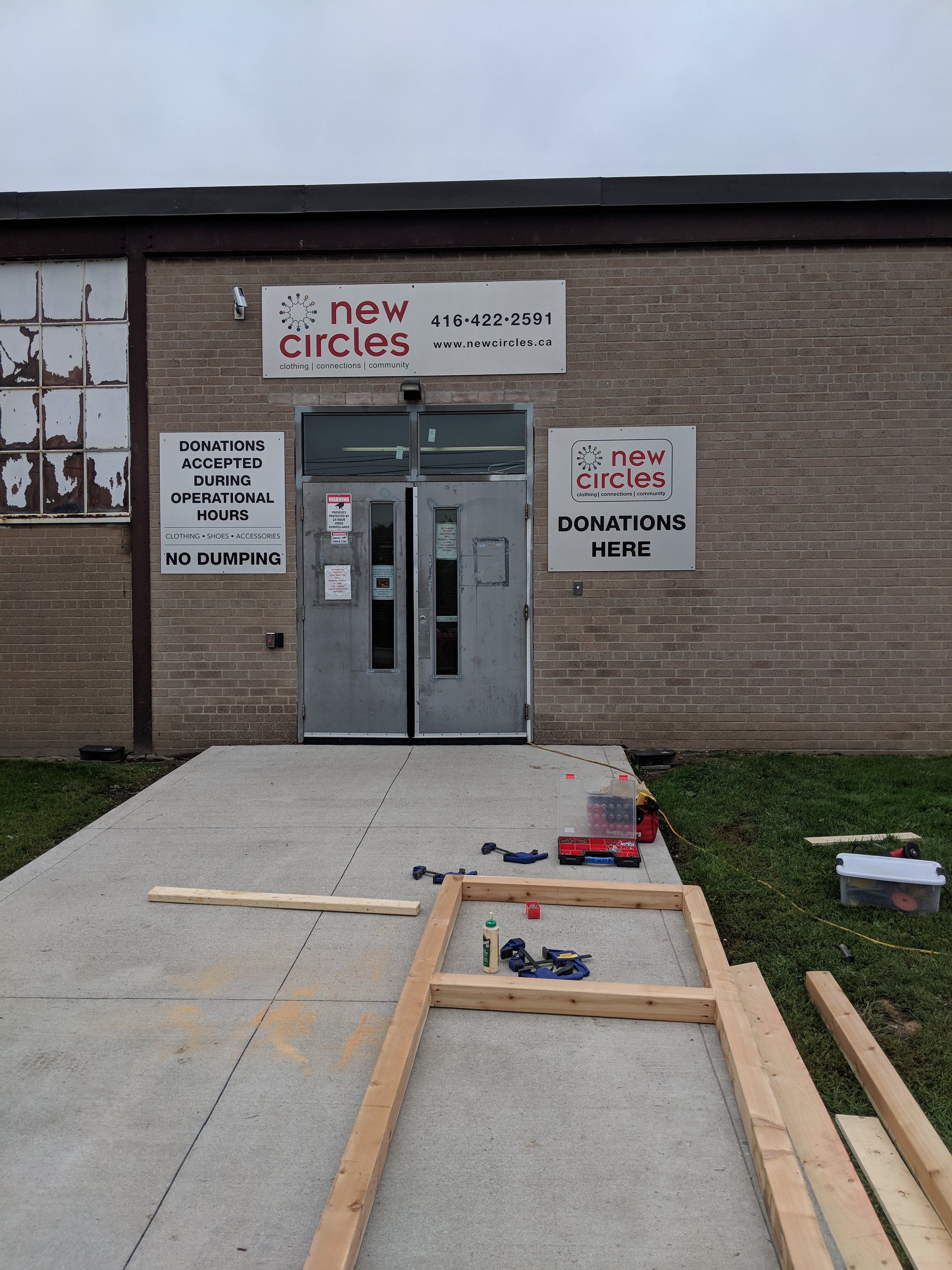 Signs still on the building and the beginnings of the sign structure.
