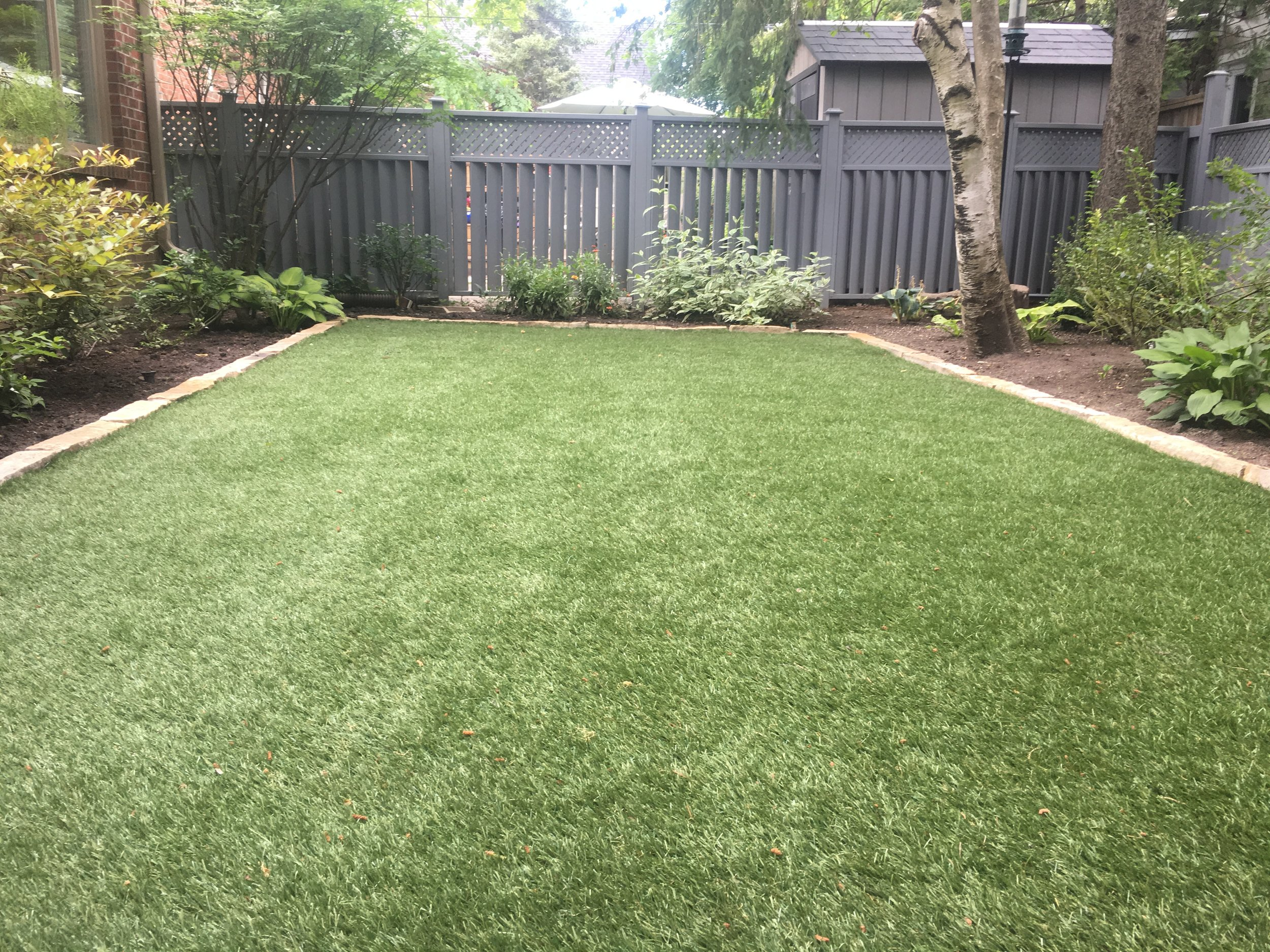 The finished product = a beautifully manicured back yard!