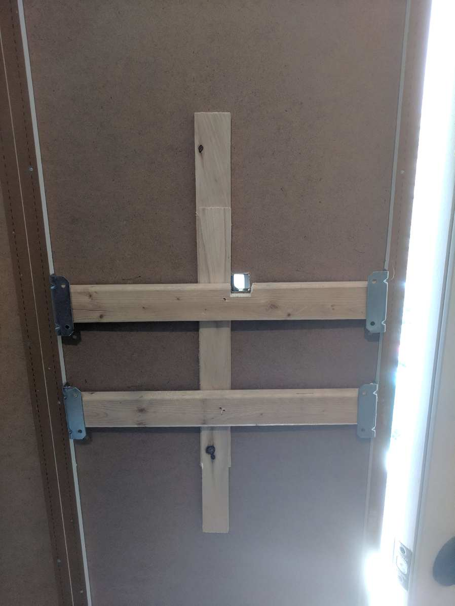 Reinforced cabinet wall in order to mount the client's Dyson vacuum for storage and charging.
