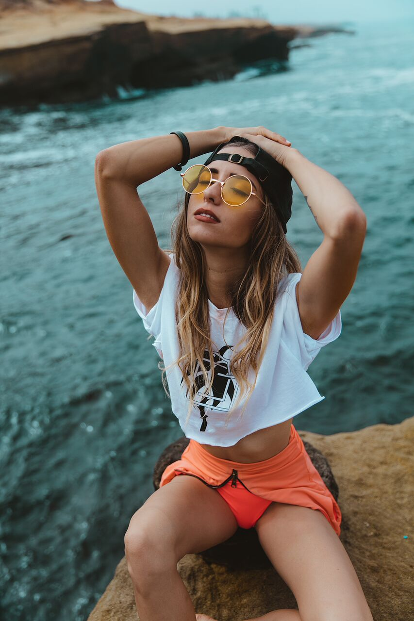 top and cap by Public Good, bathing suit by Young & Reckless, glasses by Modern Gypsy