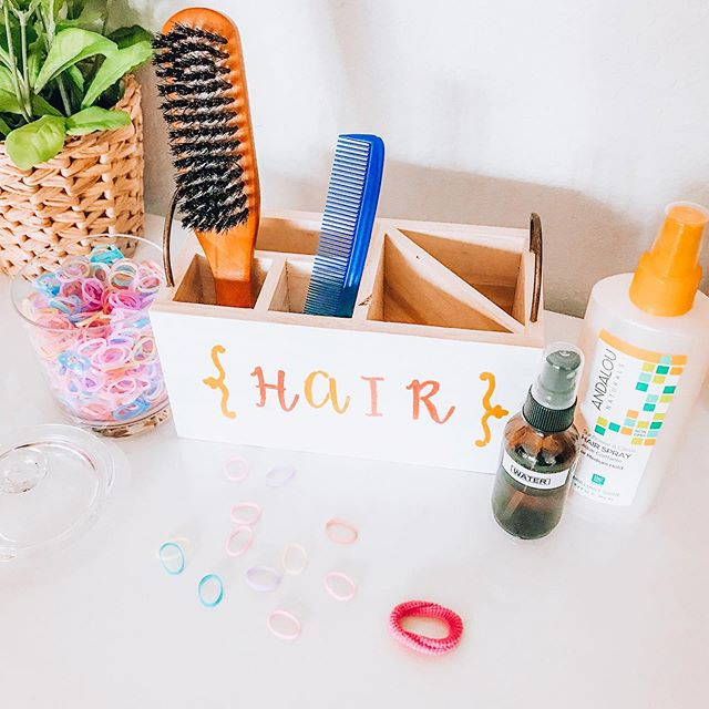 Hair Caddy!  This may end up being one of our least used items, but oh well because it was fun to spruce up! Keep all your little one's combs, brushes, sprays and hair ties in one spot for quick hair fixin' 👌🏻 I snagged this wooden caddy from Target, + some acrylic paint and stencils for the lettering. Now if Penny would let me come near her with a brush. 😅