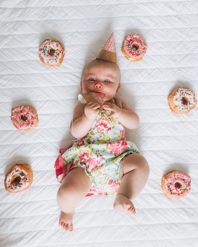 🍩🍩🍩🍩🍩🍩 SIX months have flown by, guys! A lot is going on over here.  I am rolling around like crazy, chewing on anything and everything that comes within my reach, been smashing purées for a month, laughing, smiling, teething (but no chompers yet), reaching and still watching sis act crazy.  People say my hair looks red, what do you think? Anyway, gotta run. Swipe to see what happens when mom takes something out of my mouth. 😭