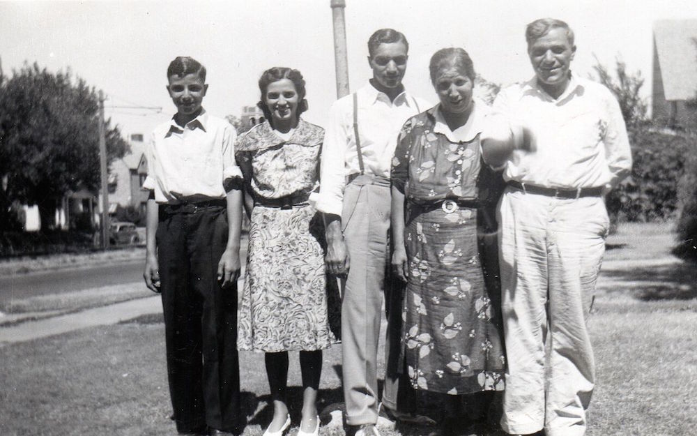 George at left with his sister Julia, brother Sam, mother Saida, and father Charlie.