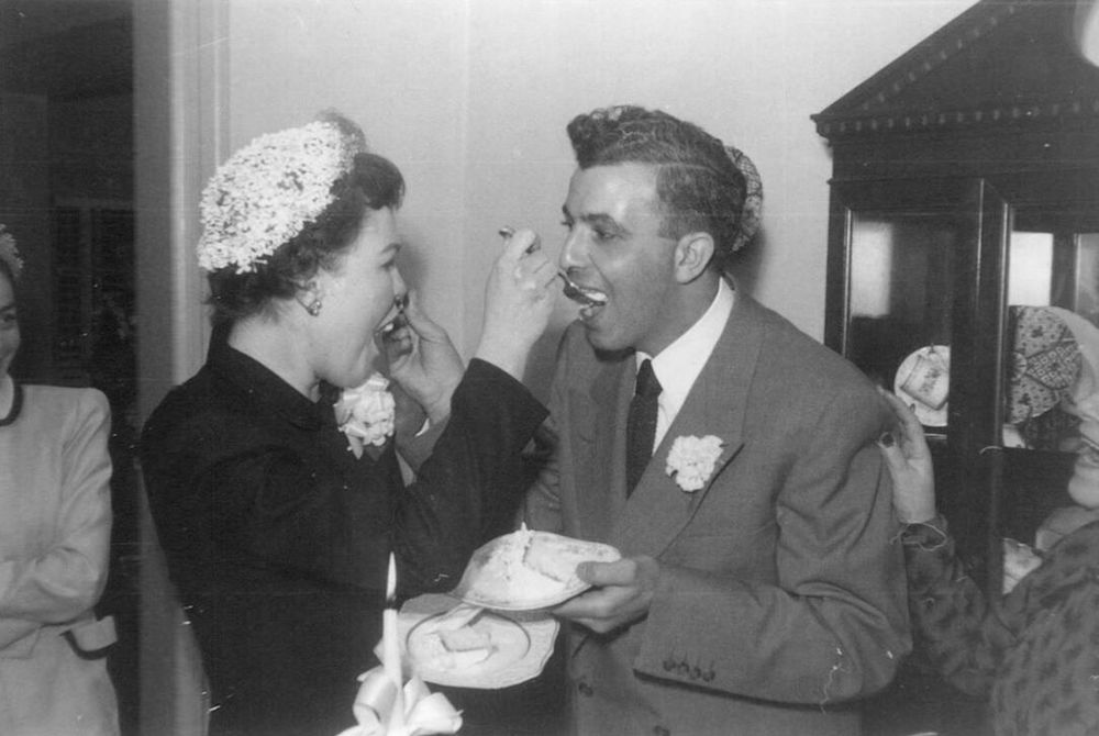 Marion and George Naifeh sharing cake at their wedding reception in Washington.