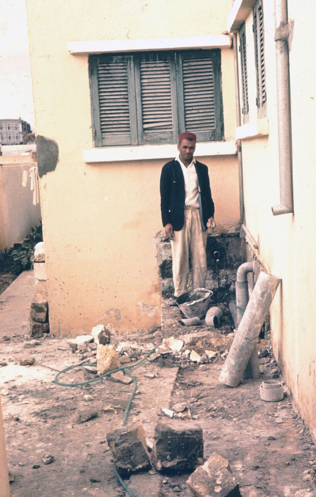 The replacement plumber standing, perplexed, outside the Naifehs' home in Baida.