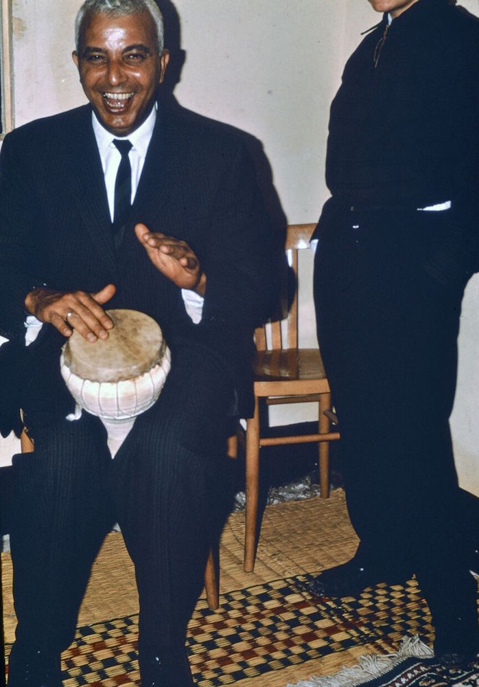 George playing a drum at a groom's party.
