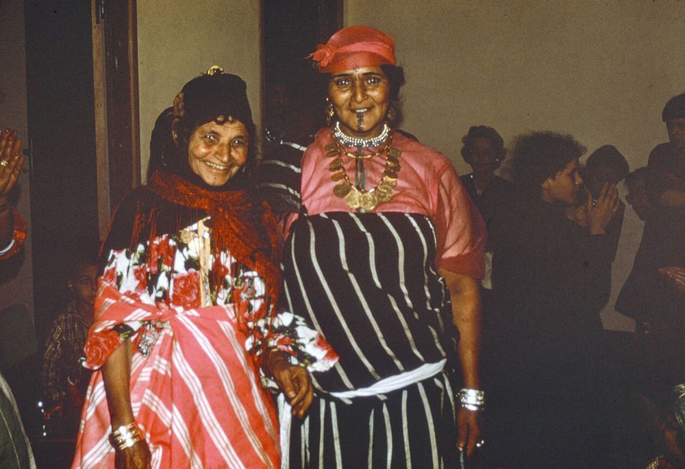Abdul Gader's mother at left, with a professional dancer, at a bride's party.