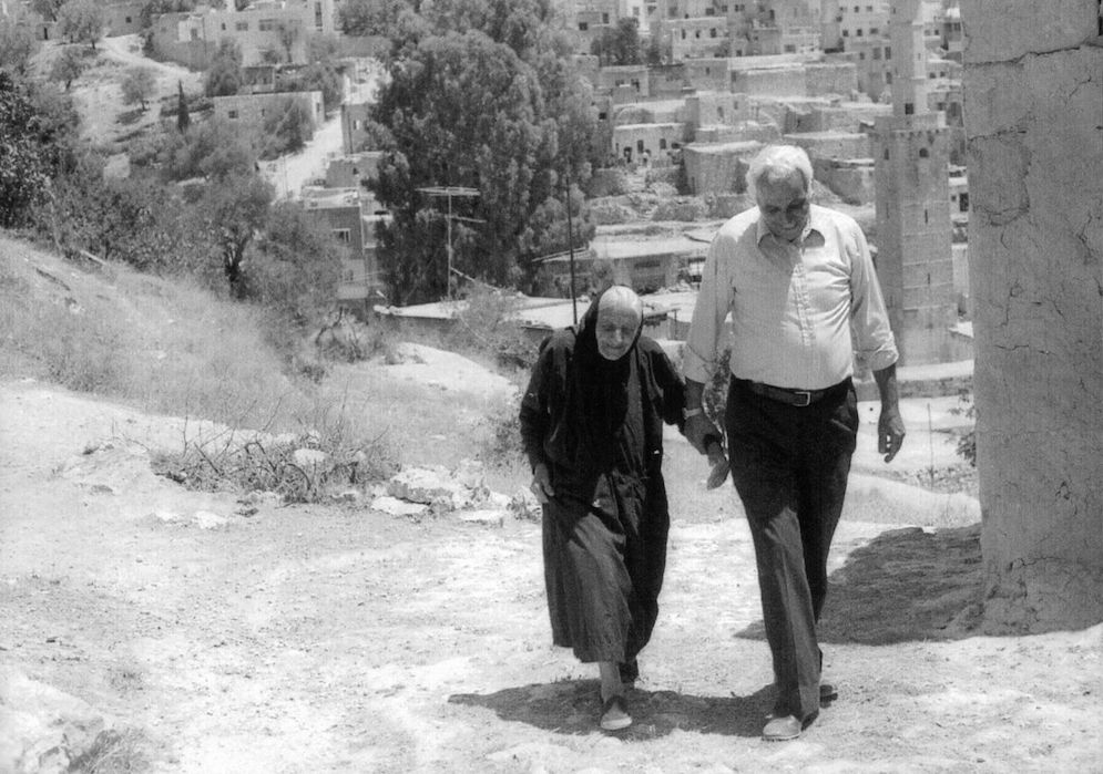 George walking with his aunt Wadia in Ajlun, the town where his father was born.