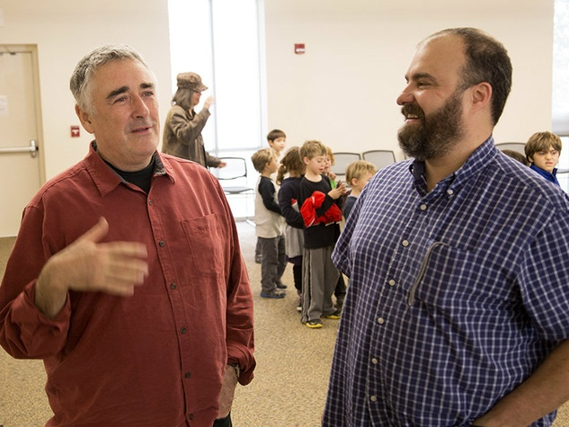 Pedro Moreno, right, chats with Fred Frith after a performance at Austin Discovery School. John Clark/Flickr