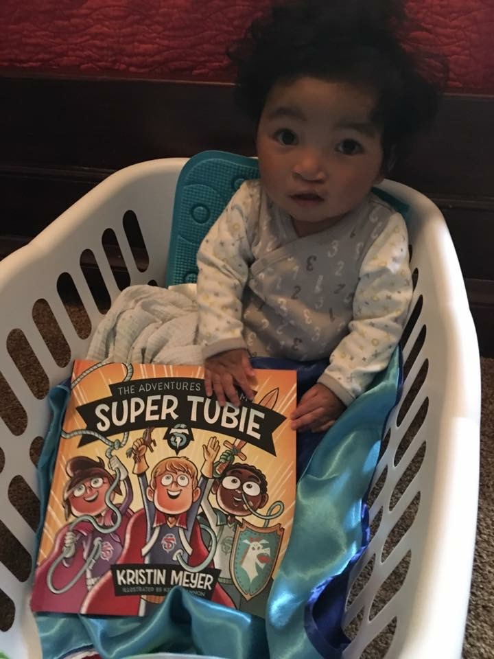 A fellow Super Tubie moments after he received his new book and Super Tubie cape! Go Tubie Power!