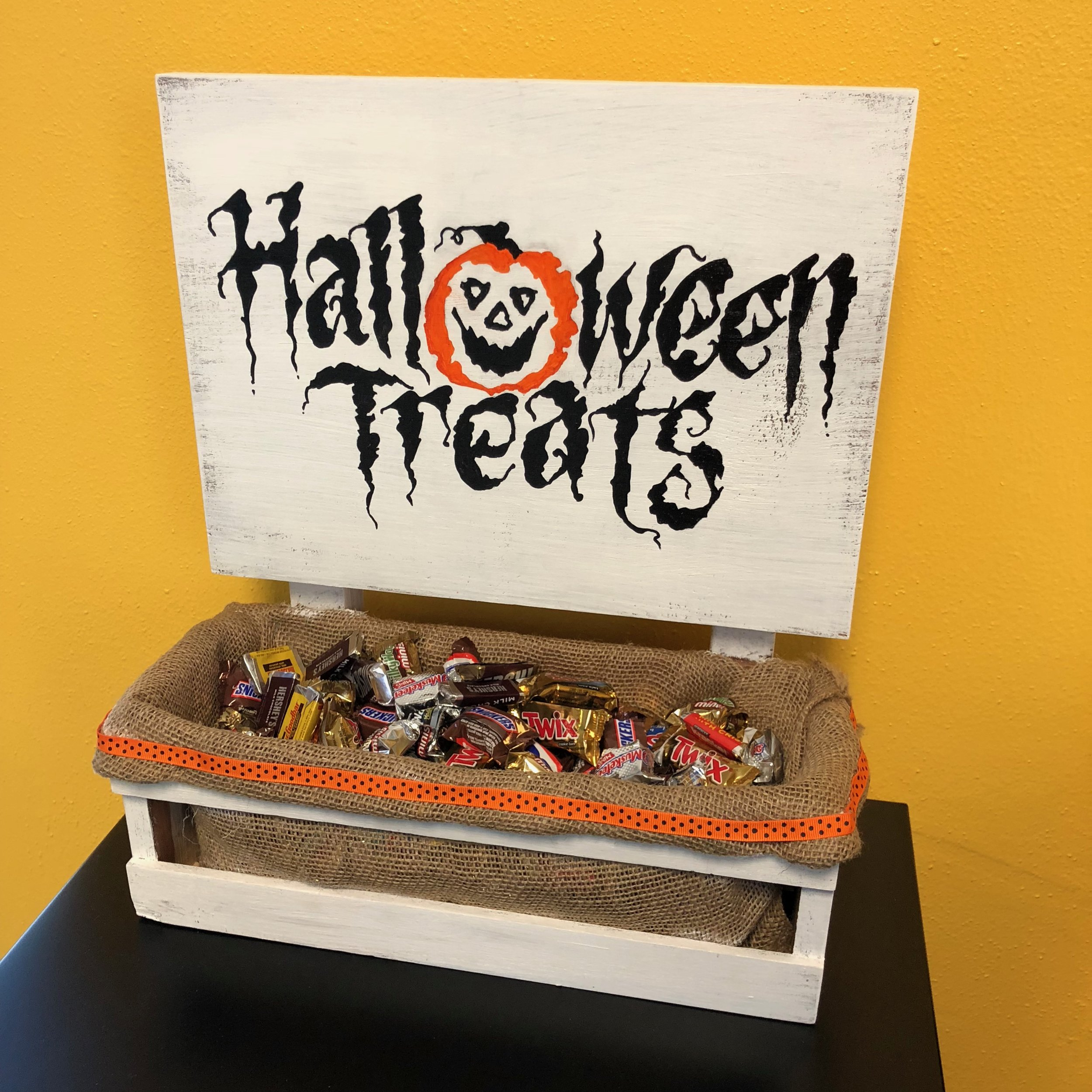 $55 - Halloween Treat Holder w/ Sign  Stain, paint, and build a custom treat holder.