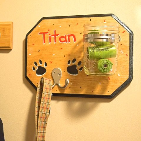 $45 - Dog Leash Hanger  Stain, paint, and build a custom dog leash hanger with treat or poo baggie jar.