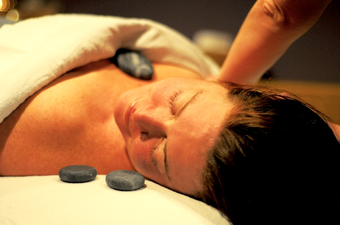 Smooth, warm stones are used to relax and warm the muscles.