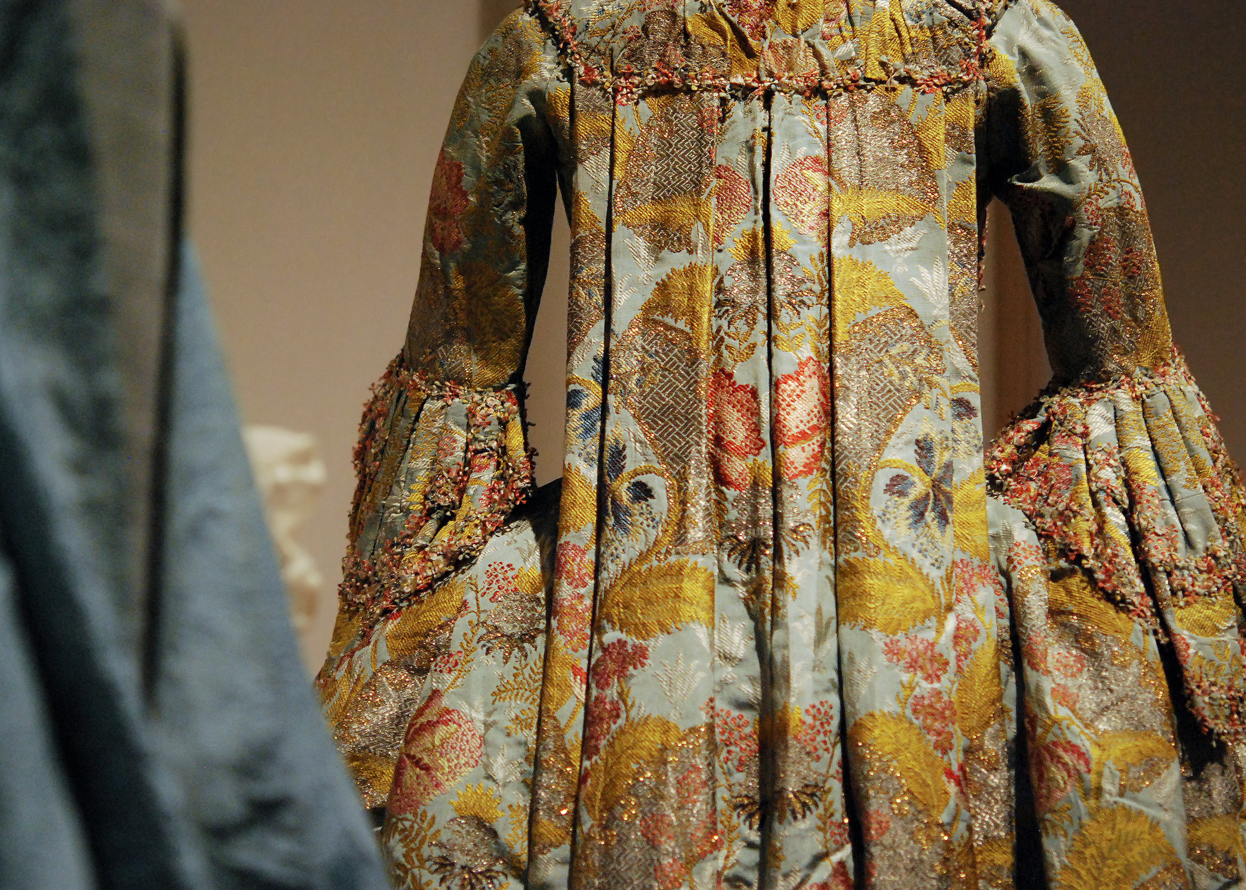 Robe A La Francaise , ca. 1760. Light blue silk faille, brocaded with polychrome silk, gold and silver metal thread, trimmed with polychrome silk fly fringe