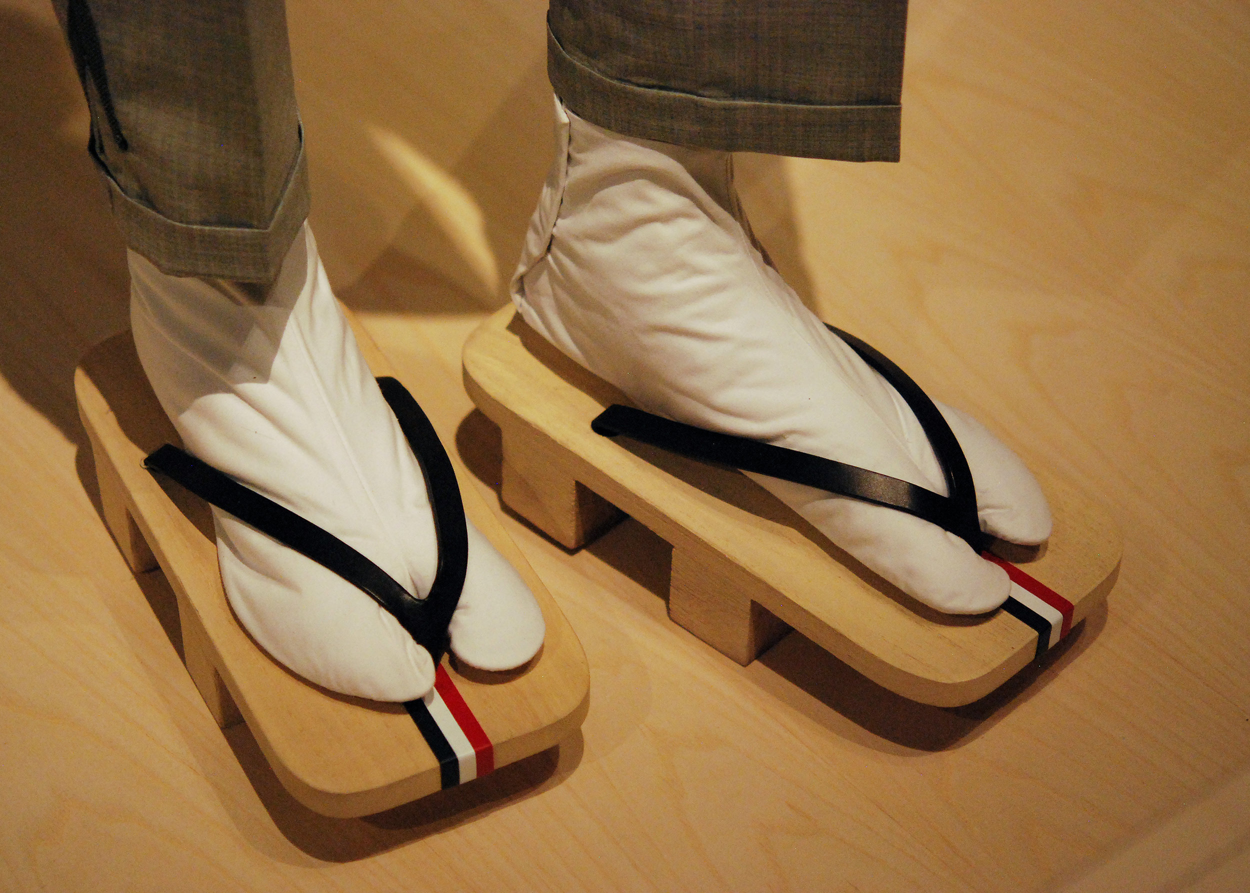 Thom Browne , Sandals, spring/summer 2016. Natural paulownia wood with black, blue, red and white leather