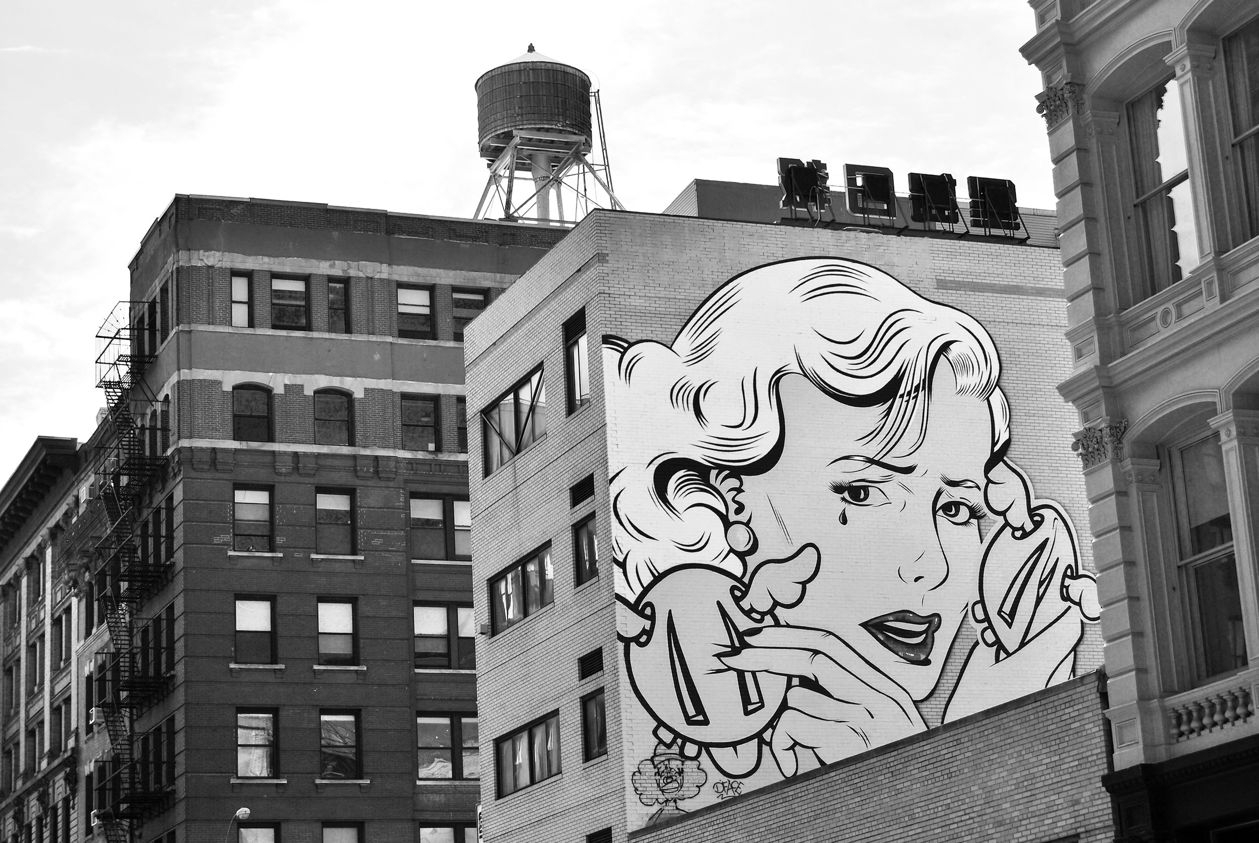 """A Dean Stockton (D*Face) mural, """" Double Crossed ,"""" on Broome Street, corner of Crosby Street"""