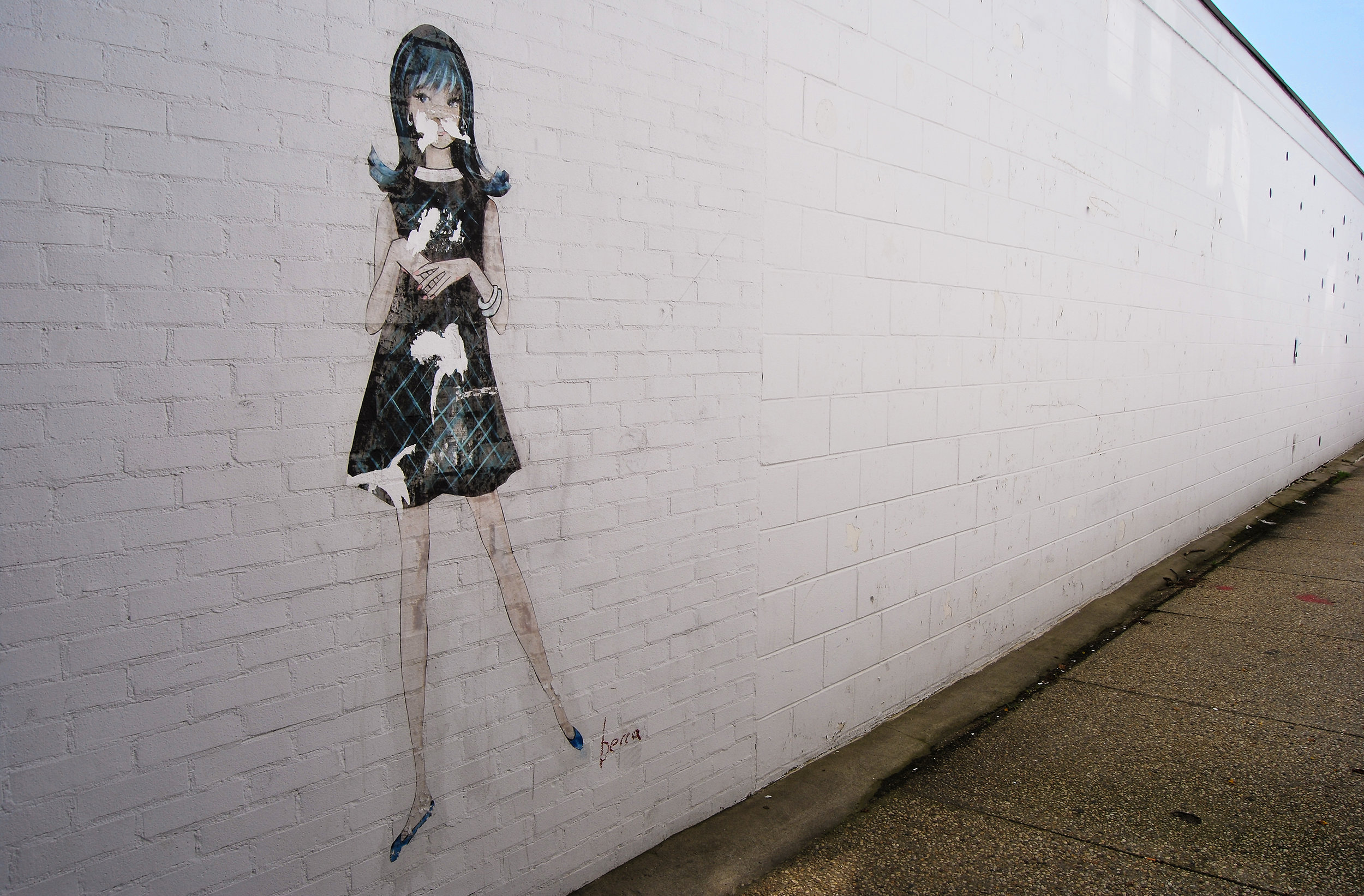 A retro-looking mural on the alley wall beside  Blue & Cream , East Hampton