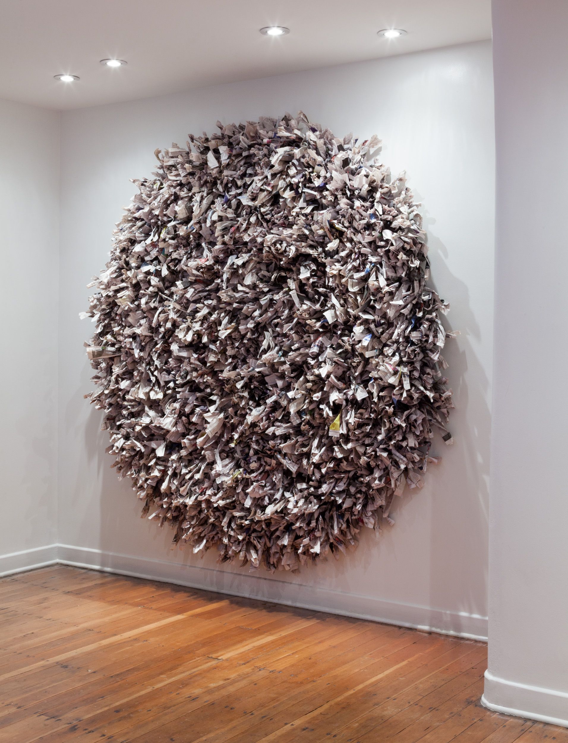Maren Hassinger   Our Lives , 2008/2018, Shredded, twisted and wrapped New York Times newspaper, 72 inches diameter