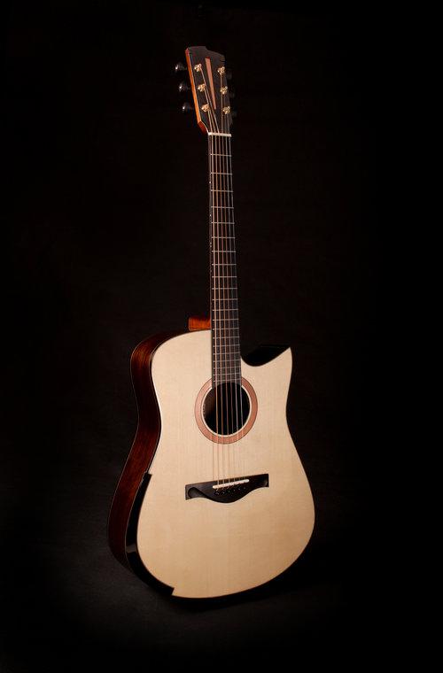 Tom Sands Guitar with Rocklite Ebano fingerboard and binding.
