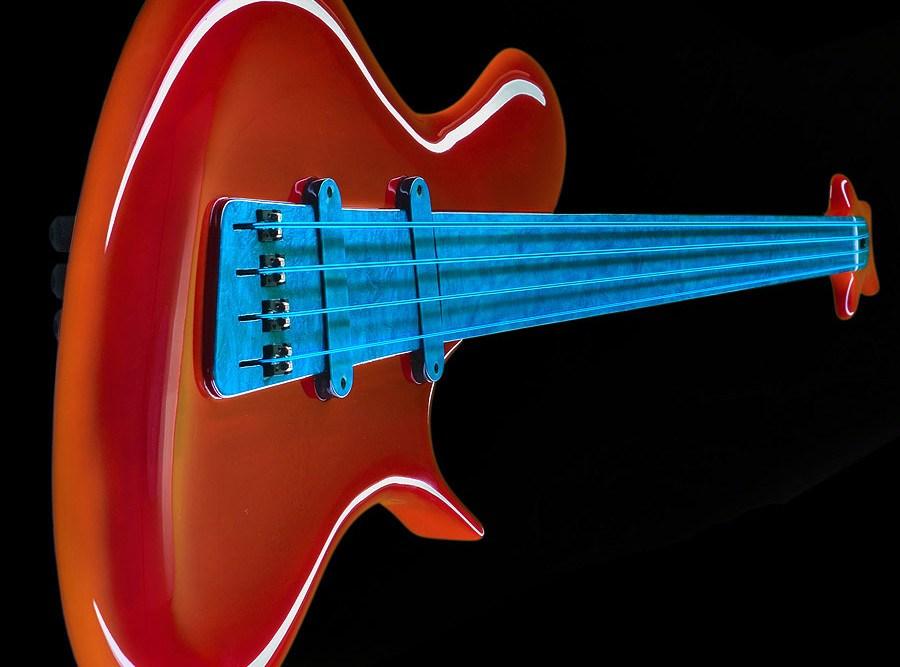 Ritter-R8-Concept-Fretless-Bass-Transparent-Red-Energy-perspective-900x667.jpg