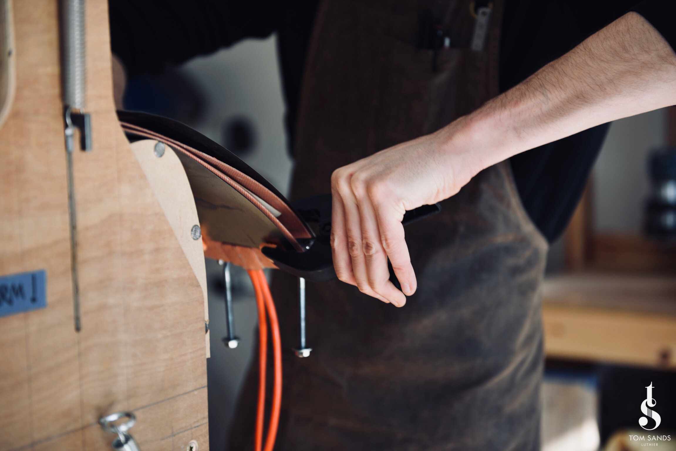 Bending the Cocobolo, armed with paper towel and alcohol (not to drink - we definitely don't advise that.)