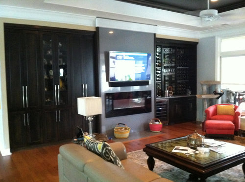AFTER: A bold, modern space providing custom storage to make the most of the room.
