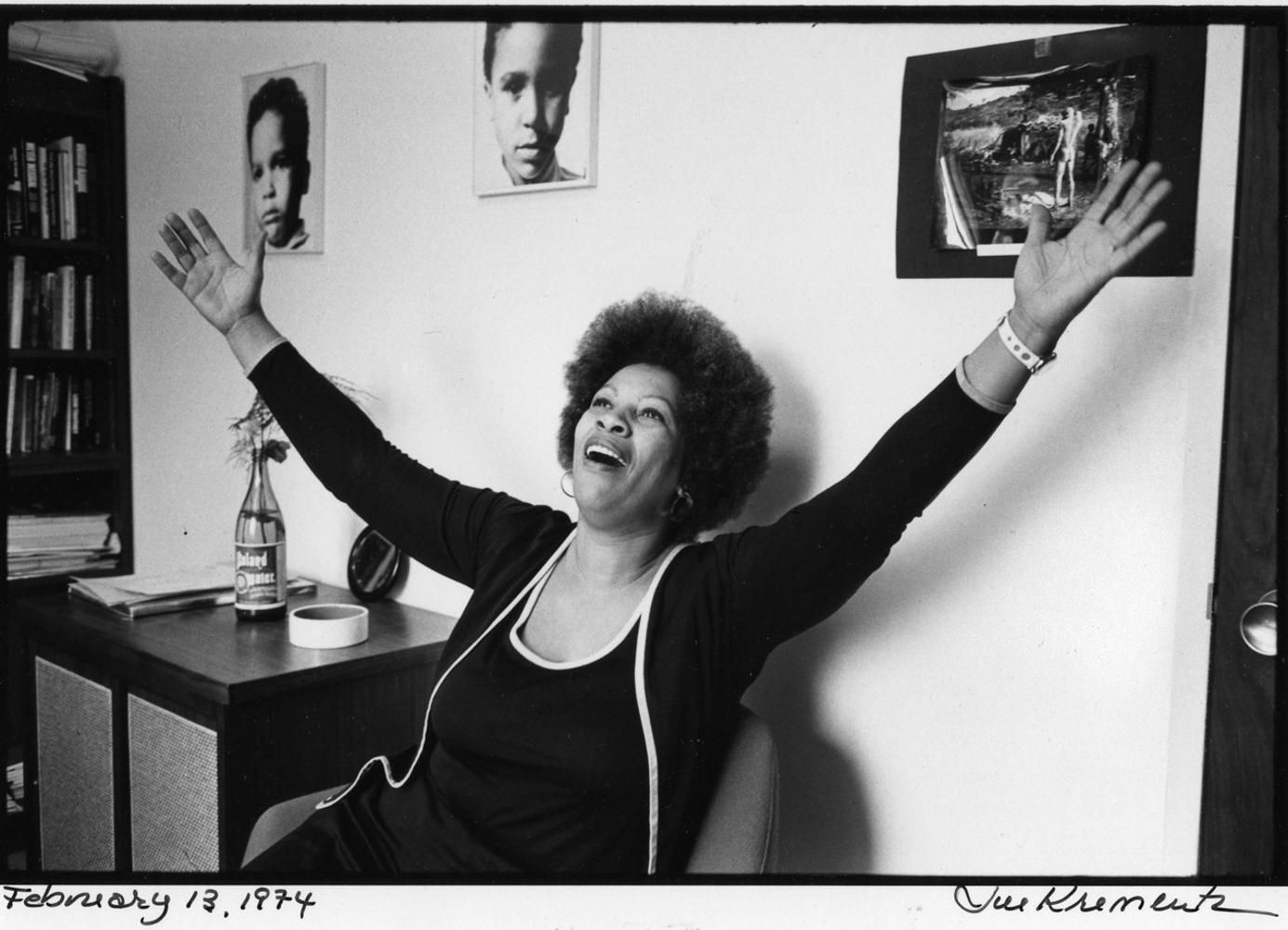"""Portrait of Toni Morrison at Random House in New York 1974, by Jill Krementz. Used under fair use guidelines  Ellah Wakatama Allfrey would carry this photo of Toni Morrison with her from desk to desk. She describes the effect of the gentle waves of her hair and her outspread arms """"I looked at her and knew that I was not only possible, but necessary."""" There's an interesting thought to be explored here on how images or artefacts can store a galvanising power for our purpose quests."""