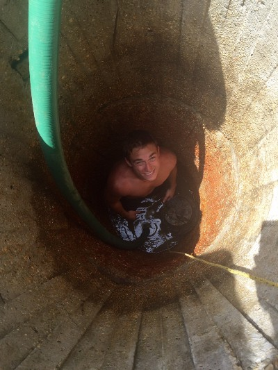Corey cleaning the well