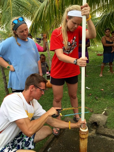 Raleigh, Savannah, and Nick installing new pipes into a broken well