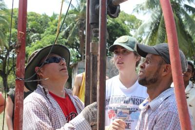 Leo, Hannah, & Rene digging a new well