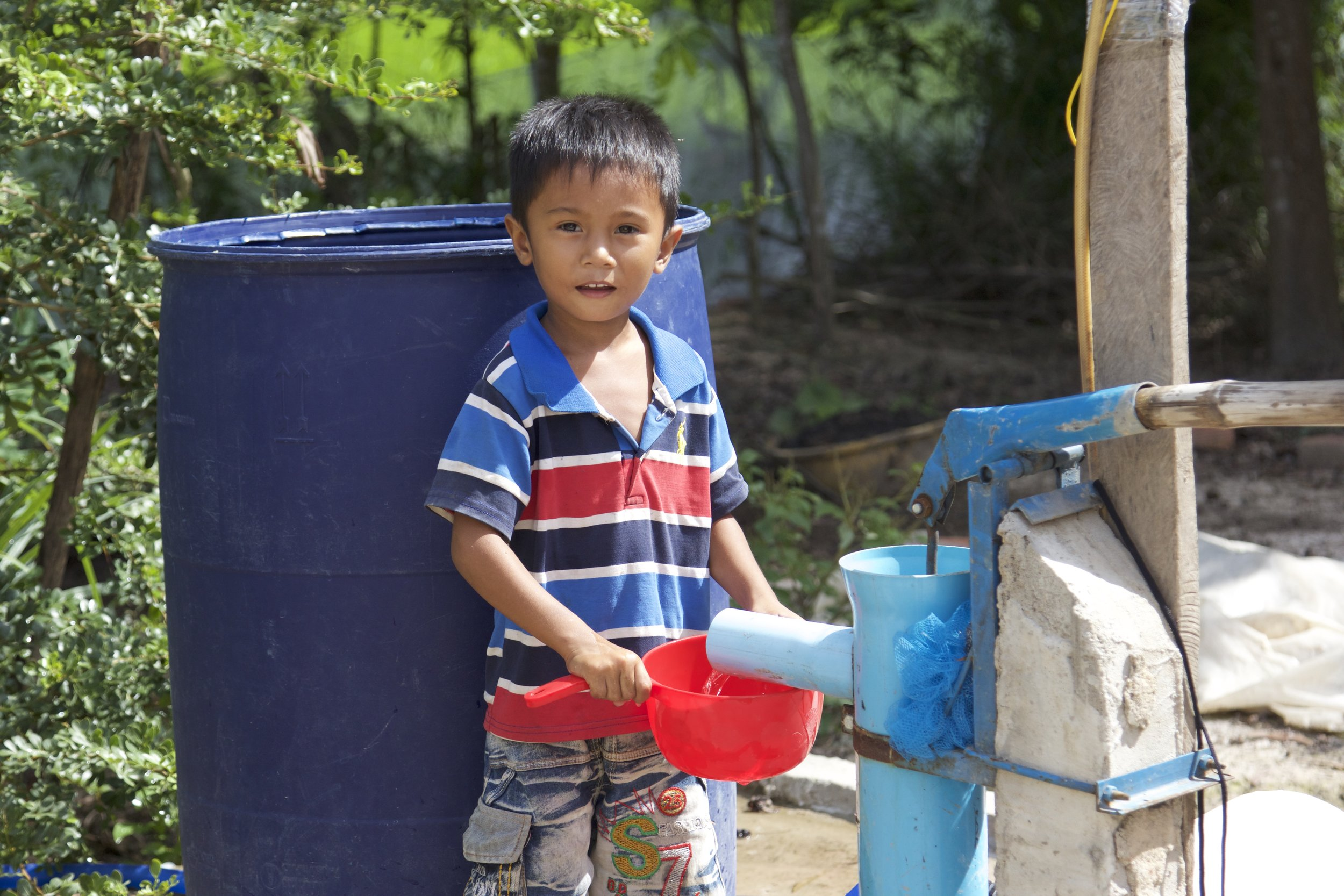 Samoan standing by his family's well