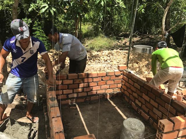 Community members work constructing a latrine in Svay Rieng Provence, Cambodia